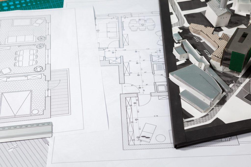 Building blueprints on an architect table
